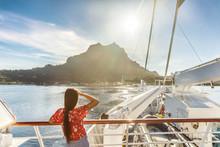 Bora Bora Island Luxury Cruise Ship Travel Tourist Woman Watching Sunset On Balcony Deck Of Europe Mediterranean Cruising Destination. Summer Vacation Cruiseship Sailing Away On Holiday.