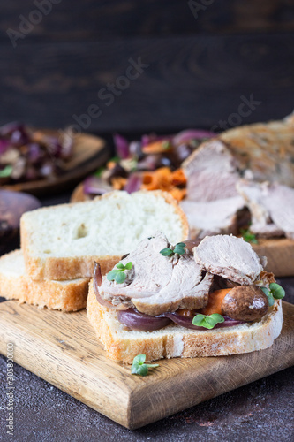 Fototapety, obrazy: Roast beef sandwich with vegetables, champion and herbs on wooden cutting board, rustic style.