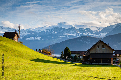 Fotobehang Vrouw gezicht small mountain village and snowy peaks of Alps in the background