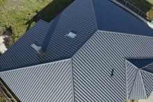 Corrugated Metal Roof And Metal Roofing. Modern Roof Made Of Met