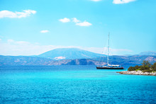 Sailing Yacht Catamaran Boat With White Sails On Turquoise Waters Of Sea.