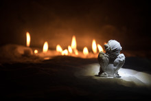 Little White Guardian Angel In Snow. Festive Background. Christmas And New Year Concept. Selective Focus