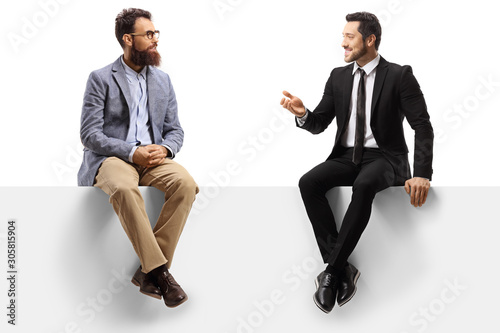 Obraz Two men sitting on a panel and having a conversation - fototapety do salonu