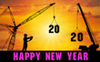 Happy New Year 2020.A female engineer inspects the move and arranges the 2020 figures at the top of the building using a crane to lift the numbers 2020.