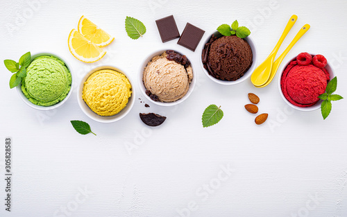 Obraz na plátně  Various of ice cream flavor ball blueberry ,lime ,pistachio ,almond ,orange ,chocolate and vanilla set up on white wooden background