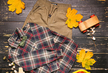 Stylish Autumn Kid Clothes With Toys On Wooden Background