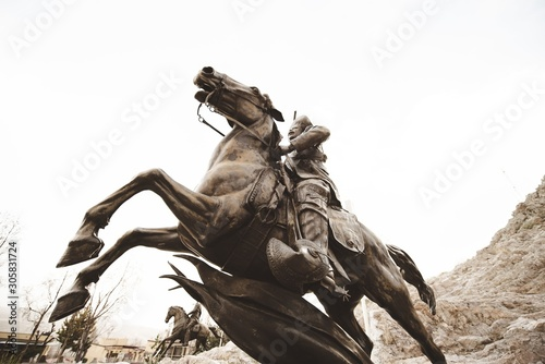 Low angle shot of a soldier riding a horse statue in Zacatecas Mexico
