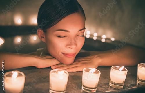 Fototapeta Spa relaxation Asian woman relaxing in hot tub jacuzzi luxury pamper resort