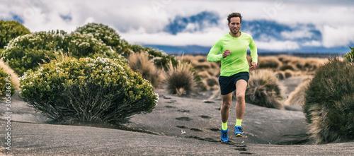 Fotomural Trail run man athlete runner running marathon in desert landscape mountain hills summer background