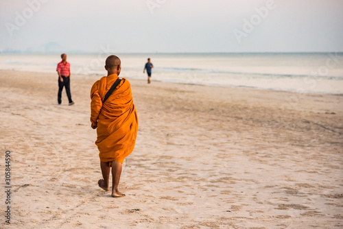 Prachuap Khiri Khan,Thailand - November, 17, 2019 : Unidentified name buddhist monk was walking alms offering food in the morning on the beach at Hua Hin Beach Prachuab Khirikhan, Thailand Canvas Print