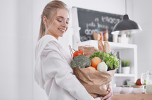 Young Woman Holding Grocery Sh...