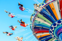 Blurred Imaged Of Colorful Summer Carnival Ride
