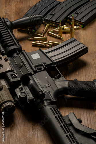 Cuadros en Lienzo  m4 rifle with optical sight, ammunition and cartriges