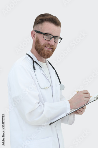 Valokuva medical doctor writes a medical report. isolated on white