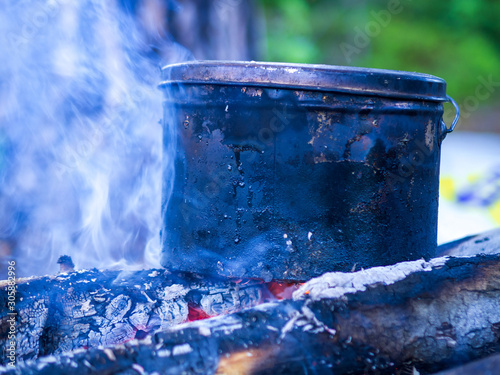 Fotografía Bowler Sasha at the stake, Cooking food at the stake outdoors scene