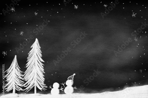 Obraz na plátne drawing of pine tree with snowman standing on land over chalk black board backgr