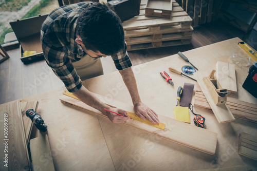 Spoed Foto op Canvas Wanddecoratie met eigen foto Above high angle view portrait of his he nice attractive focused skilled experienced hardworking guy creating building project at home modern industrial loft brick style interior indoors