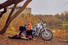 Red-haired Female Biker Next T...