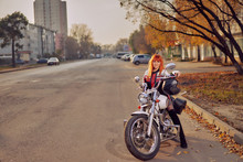 Red-haired Female Biker On The...