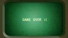 Game Over Message With Sad Face On Old Green Computer Terminal Screen With Frame
