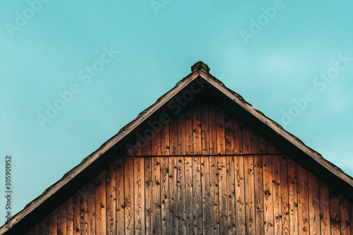Gable shed roof and blue sky Fototapet