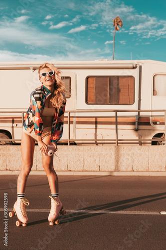 Fototapeta retro campervan with hippie californiagirl. california van lifestyle obraz