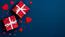 Valentine Day Background With Red Gift Boxes And Hearts On Blue. Flat Lay, Top View. Love And Romance Concept.