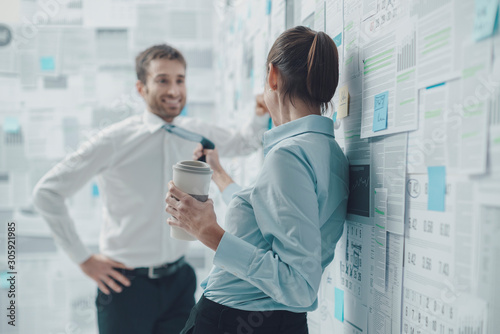 Fotografie, Tablou Colleagues flirting during a coffee break