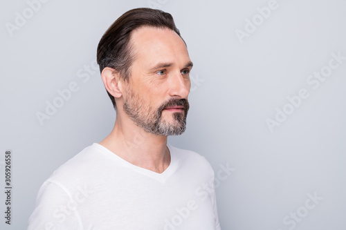 Closeup profile photo of handsome aged man seriously looking side empty space see mirror new wrinkles going to apply anti age cream wear white t-shirt isolated grey color background - fototapety na wymiar