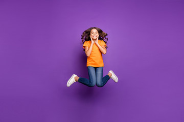 Full length body size view of her she nice attractive charming playful funky cheerful cheery wavy-haired girl jumping having fun free time isolated on lilac purple violet pastel color background