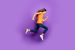 Full length body size view of her she nice attractive lovely funky cheerful cheery wavy-haired girl jumping running fast action isolated over lilac purple violet pastel color background