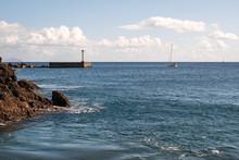 Sea And Blue Sky And Lighthouse