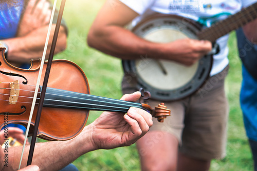Violin and banjo played outdoors in a popular country party Canvas Print