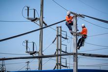 Electricians Are Climbing On E...