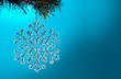 canvas print picture - toy snowflake on a background of Christmas lights