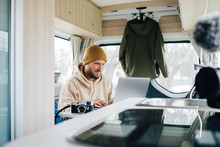 Work And Travel With Campervan In Australia Young Man Is Working In His Van During Vacation Notebook On The Road Remote Working Business