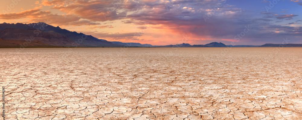 Fototapeta Cracked earth in remote Alvord Desert, Oregon, USA at sunset
