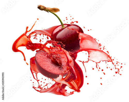 Photo sweet cherries in juice splash isolated on a white background