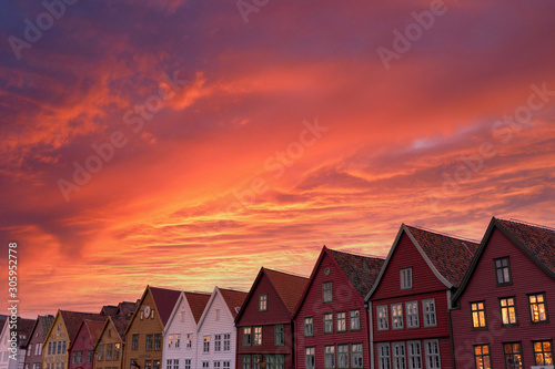 Papiers peints Grenat Rooftops from Bergen/Norway with dramatic colored red skies during sunset.