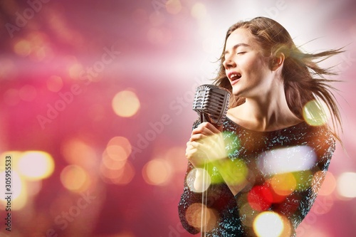 Female Rockstar Singing With Retro Vintage Microphone - 305955533