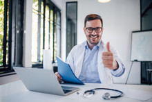 Portrait Of A Smiling Doctor Showing Thumbs-up.