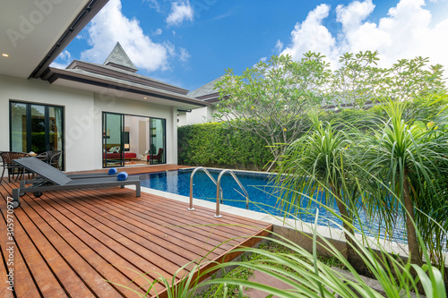 swimming pool and decking in garden of luxury home Wallpaper Mural