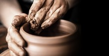 Hands Of Potter Making Clay Po...