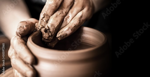 Obraz Hands of potter making clay pot on black background - fototapety do salonu
