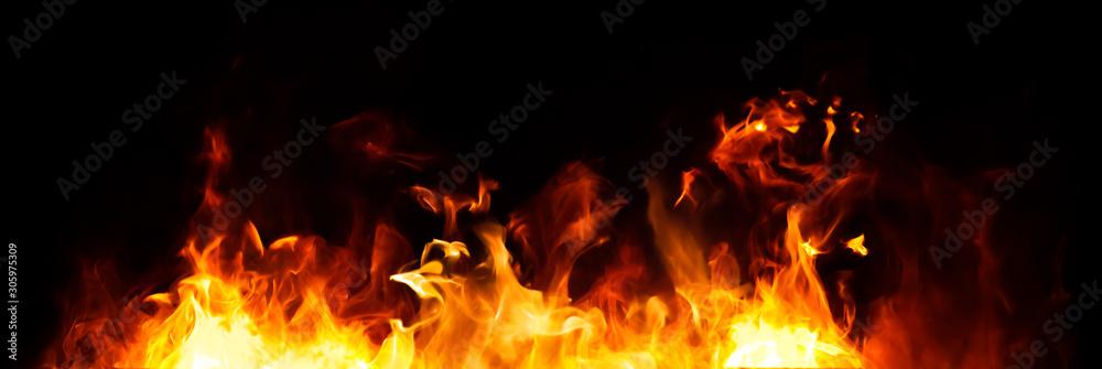 Fototapeta Panorama Fire flames on black background.
