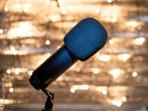 Photo Microphone with defocused bokeh lights in background