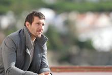 Serious Pensive Man Contemplating Views In Winter