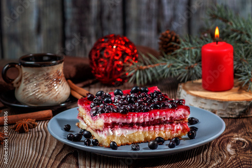 Slice Of Christmas Cheesecake With Blackcurrant Filling On A Rustic Wooden Table Buy This Stock Photo And Explore Similar Images At Adobe Stock Adobe Stock