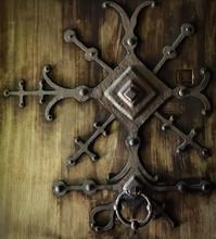 Ornate Iron Door Knocker On Wood Door