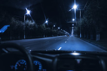 View From Inside The Car Driving At Night In The City Traffic Highway